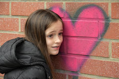 Girl and graffiti heart royalty free stock photo