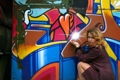 A girl and a graffiti star Stock Photos