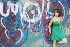 Girl on graffiti wall Stock Image
