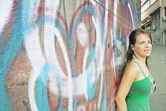 Girl and graffiti wall Stock Image