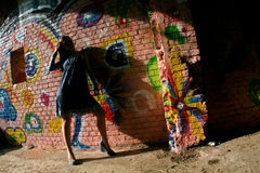 Girl and graffiti wall Stock Photo