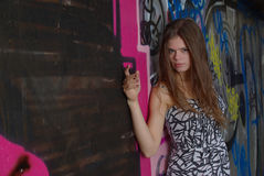 Girl and graffiti wall Royalty Free Stock Photography
