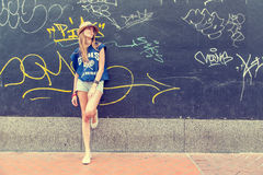 Girl on graffiti wall Royalty Free Stock Photography