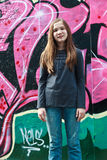 Girl by a grafitti wall. Girl standing in front of a graffiti wall stock images