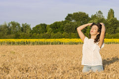 Girl at grain field Royalty Free Stock Photography