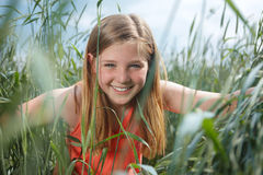 Girl in grainfield Stock Image