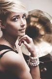 Girl and gramophone Stock Images