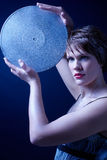 Girl with gramophone record Stock Photography