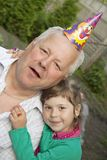 The girl with the grandfather Royalty Free Stock Images