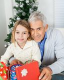 Girl And Grandfather With Christmas Gifts Royalty Free Stock Image