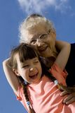 Girl with grandma Stock Photos