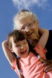Girl with grandma. On sky royalty free stock image