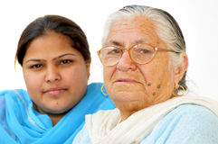 Girl and grandmother. Shot over white background Royalty Free Stock Photography