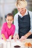 Girl grandmother baking Royalty Free Stock Photos