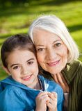 Girl With Grandmother At Campsite Royalty Free Stock Photography