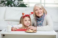 Girl And Grandmother With Cardpaper At Home Stock Photography