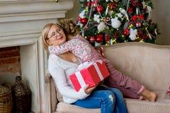 Girl and grandmother with Christmas gifts Stock Photography