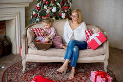 Girl and grandmother with Christmas gifts Royalty Free Stock Photo