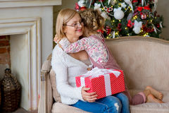 Girl and grandmother with Christmas gifts Stock Images