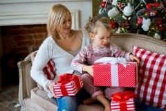Girl and grandmother with Christmas gifts Stock Photos