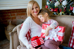 Girl and grandmother with Christmas gifts Royalty Free Stock Photography