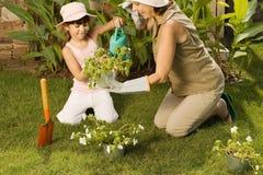 Girl and grandmother gardening Stock Photo