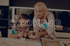 Girl and Grandmom Make Biscuits. Family Holiday. royalty free stock image
