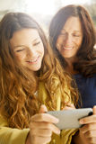 Girl and grandmother with mobile phone Royalty Free Stock Photo