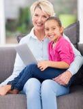 Girl grandmother notebook computer royalty free stock photos