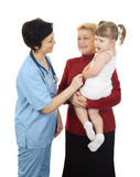 Girl with grandmother on reception at the doctor Royalty Free Stock Images