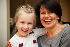 Girl and grandmother smiling Stock Photos
