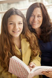 Girl and grandmother studying Royalty Free Stock Photo