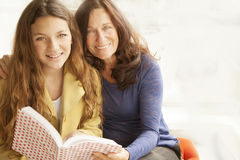 Girl and grandmother studying. Girl and grandmother reading a book Stock Photography