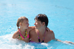 Girl with grandmother in the swimming pool Stock Photography