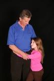 Girl and grandpa Stock Photography