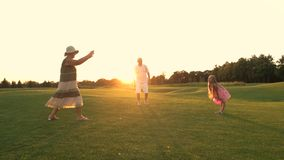 Girl and grandparents playing ball. stock footage