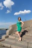 Girl on a granite embankment Stock Photo