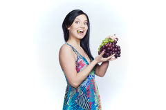Girl with grape Stock Images