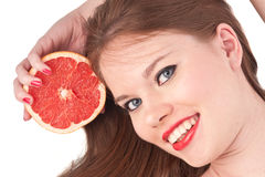 Girl and grapefruit. The beautiful girl with red lips and grapefruit isolated on white Royalty Free Stock Photography