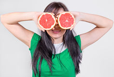 Girl with grapefruit Royalty Free Stock Photo