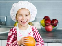Girl with grapefruit Royalty Free Stock Photography