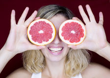 Girl with grapefruit Stock Photos