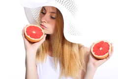 Girl with a grapefruit Royalty Free Stock Images
