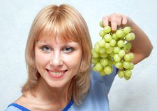 The girl and grapes. Royalty Free Stock Photography