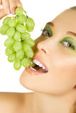Girl with grapes Royalty Free Stock Image