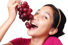 Girl with grapes Stock Photos
