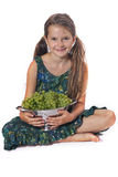 Girl with grapes Stock Images