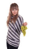 Girl with grapes Royalty Free Stock Images