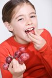 girl with grapes Royalty Free Stock Photography