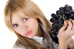Girl with grapes cluster Stock Images